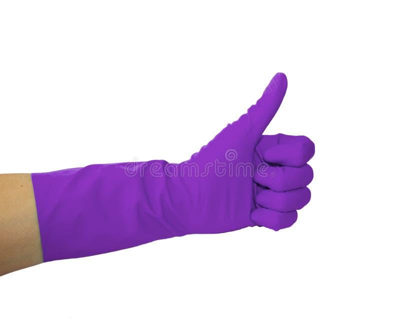 Vista ascendente cercana de la mano humana con el guante de goma que muestra la autorización o aprobar la muestra con el pulgar p fotografía de archivo