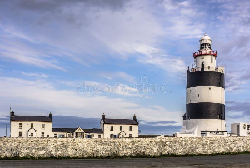Vista cênico do farol do gancho, condado Wexford, Irlanda fotografia de stock royalty free