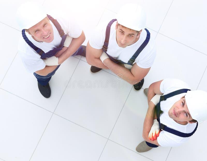 Vista da parte superior - grupo de trabalhadores da construção fotografia de stock