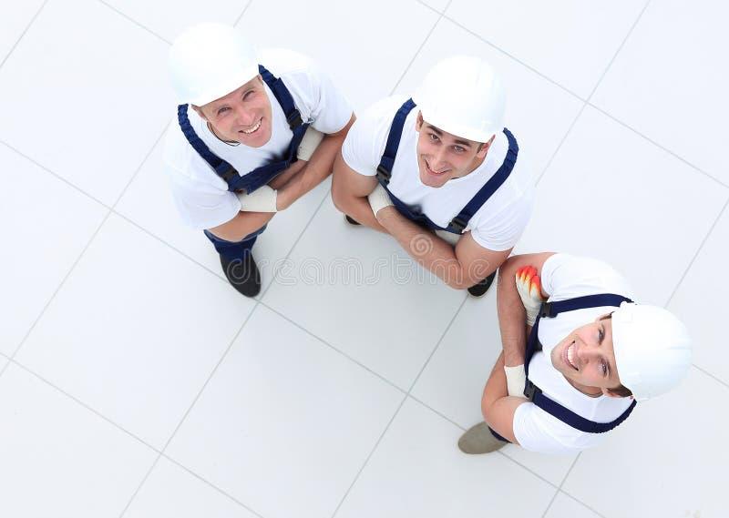 Vista da parte superior - grupo de trabalhadores da construção foto de stock royalty free