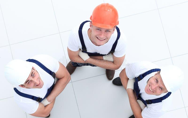 Vista da parte superior - grupo de trabalhadores da construção imagens de stock