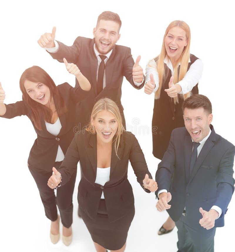 Vista da parte superior sustentação feliz da equipe do negócio polegares acima fotografia de stock royalty free