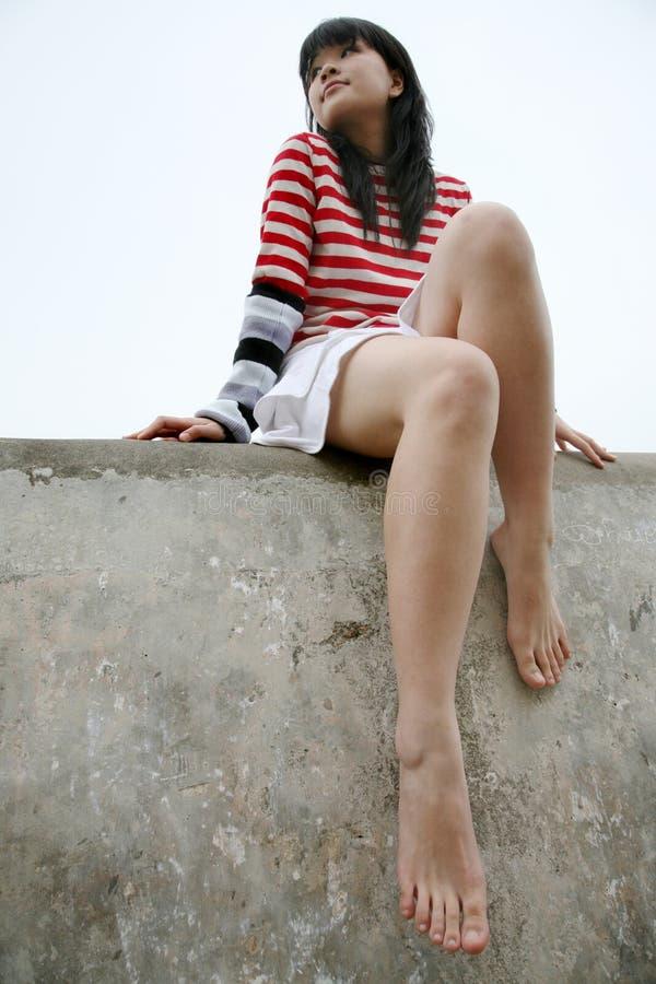 Vista de assento da menina asiática ao lado fotografia de stock