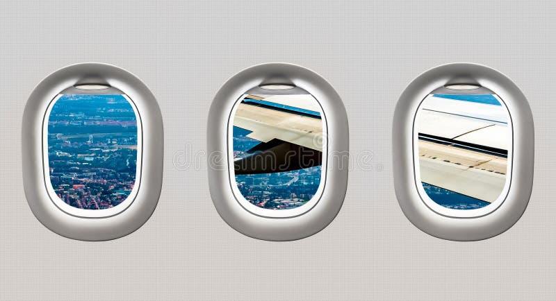 Vista del ala y de la ciudad grande de ventanas del aeroplano stock de ilustración