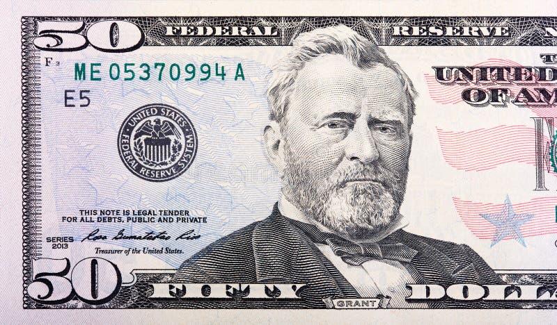 Vista del primo piano dei buoni del Tesoro dei 50 Stati Uniti del dollaro fotografia stock