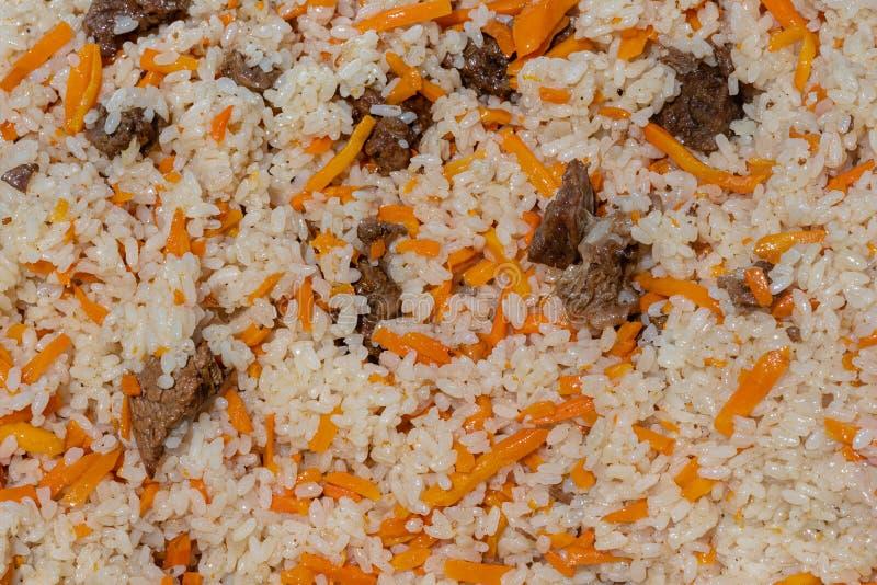 Vista del primo piano del fondo saporito asiatico dell'alimento Piatto culinario orientale tradizionale - pilaf fotografia stock