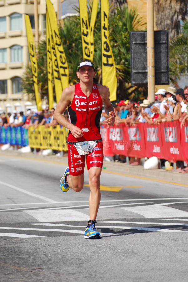 Funcionamiento profesional del triathlete de Ironman fotografía de archivo