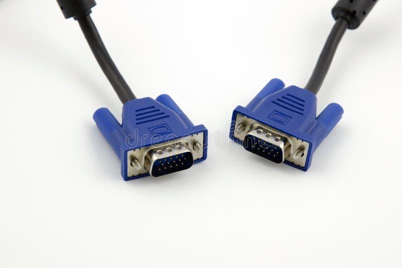 Vista detallada de dos conectores video de VGA con los cables negros imagenes de archivo