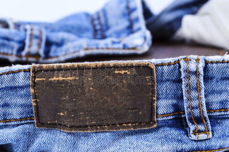 Vista di cuoio vuota del contrassegno dei jeans fotografie stock libere da diritti