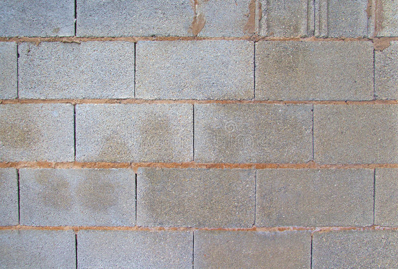 Vista di un muro di mattoni grigio Immagine di priorità bassa immagine stock