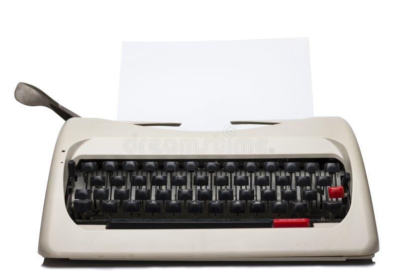 Vista dianteira da máquina de escrever com papel vazio fotos de stock royalty free