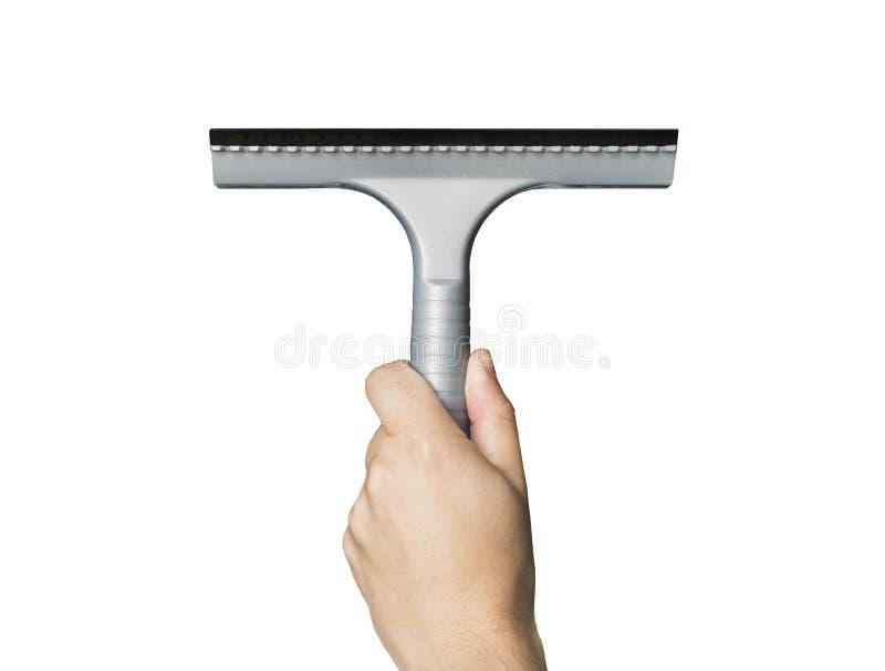 Vista dianteira do limpador masculino da terra arrendada da mão verticalmente no fundo branco Rodo de borracha cinzento na mão do imagens de stock royalty free