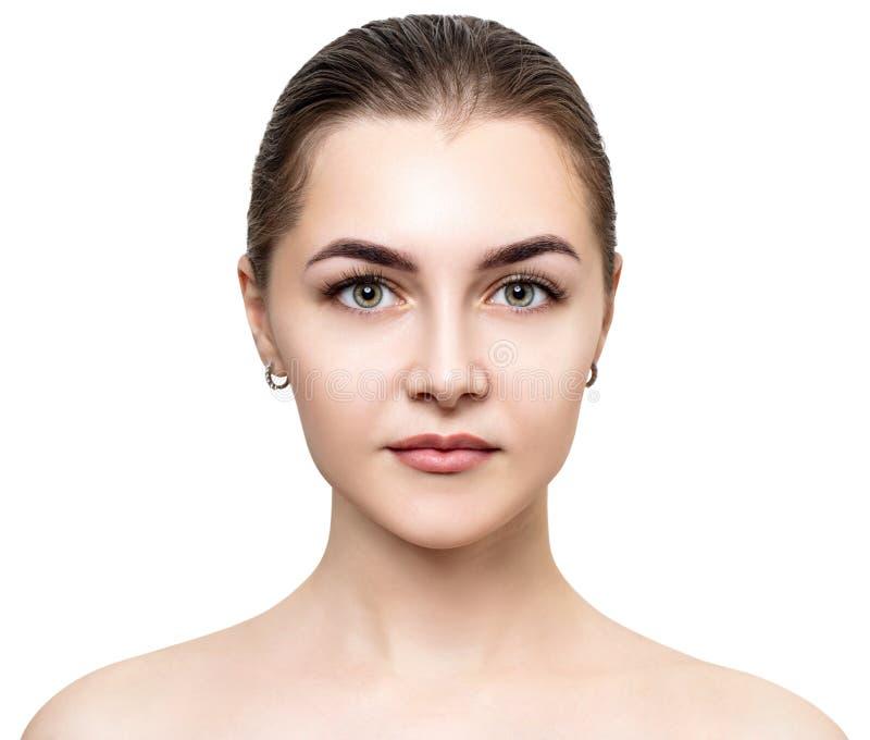 Vista dianteira na cara fêmea bonita com pele perfeita fotos de stock royalty free