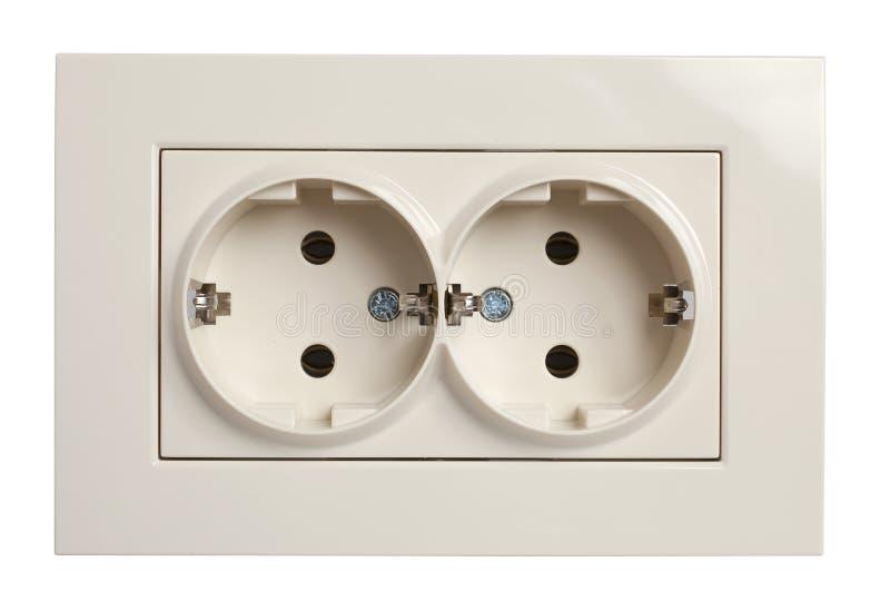 Vista frontale dell'incavo elettrico gemellato dello sbocco in o beige e isolata fotografie stock libere da diritti
