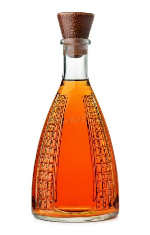 Vista frontale della bottiglia adenoida piena del cognac fotografia stock libera da diritti