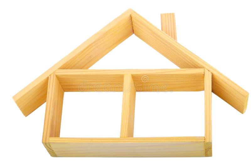 Casa de madeira isolada com um assoalho e um telhado fotos de stock