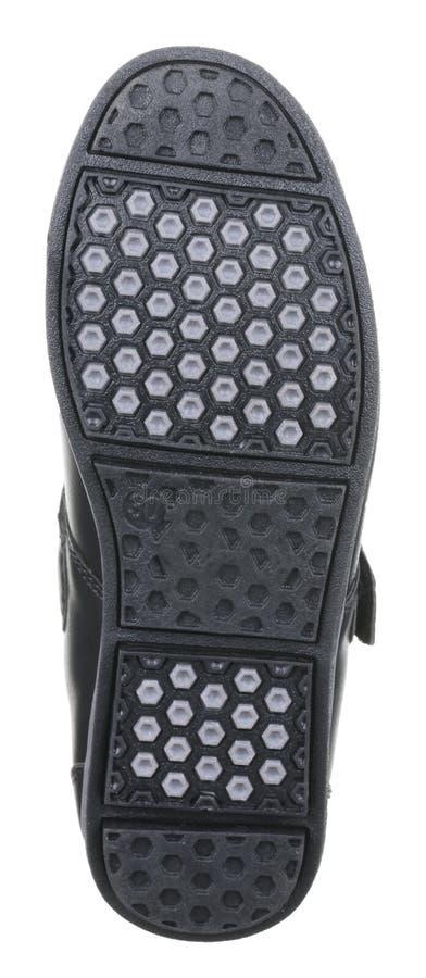 Vista inferior da sola pontilhada da bota masculina de couro preta do verão imagem de stock