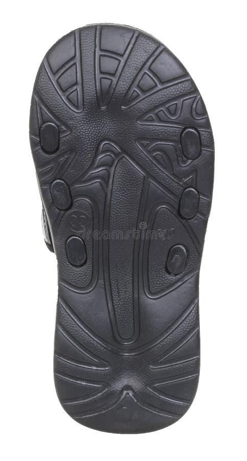 Vista inferior de la zapatilla de deporte masculina de goma negra de la playa foto de archivo libre de regalías