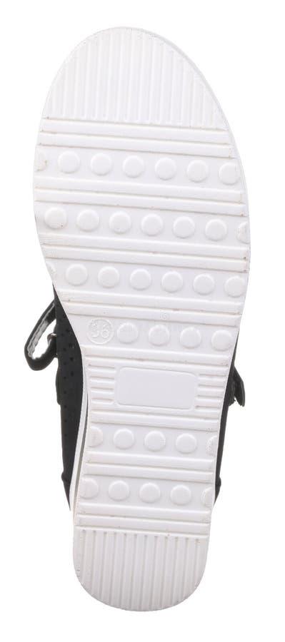 Vista inferior del zapato perforado blanco y negro del ante de las mujeres fotos de archivo libres de regalías