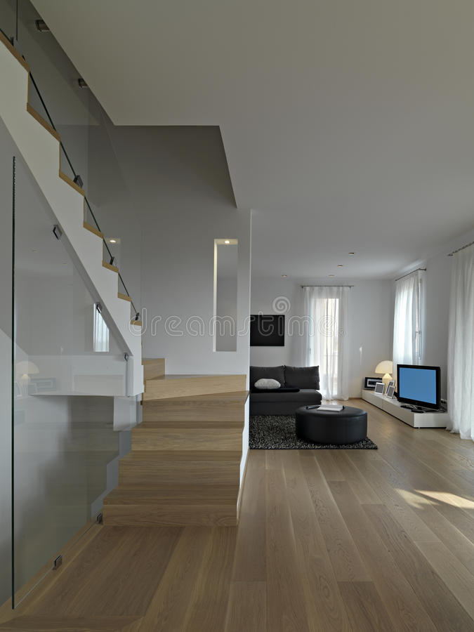 Vista interior da sala de visitas moderna com escadaria fotos de stock