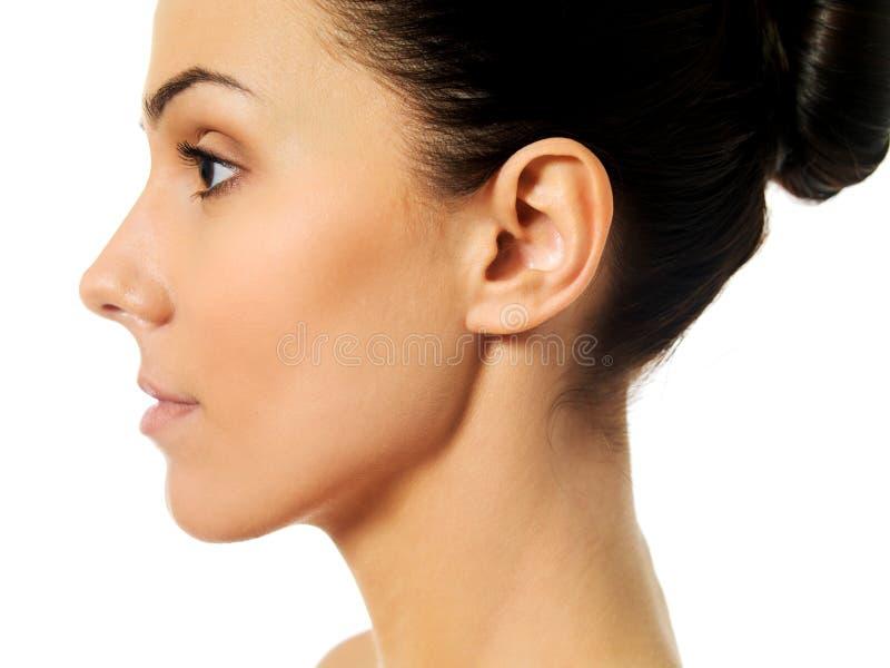 Vista lateral da cara da jovem mulher imagens de stock royalty free
