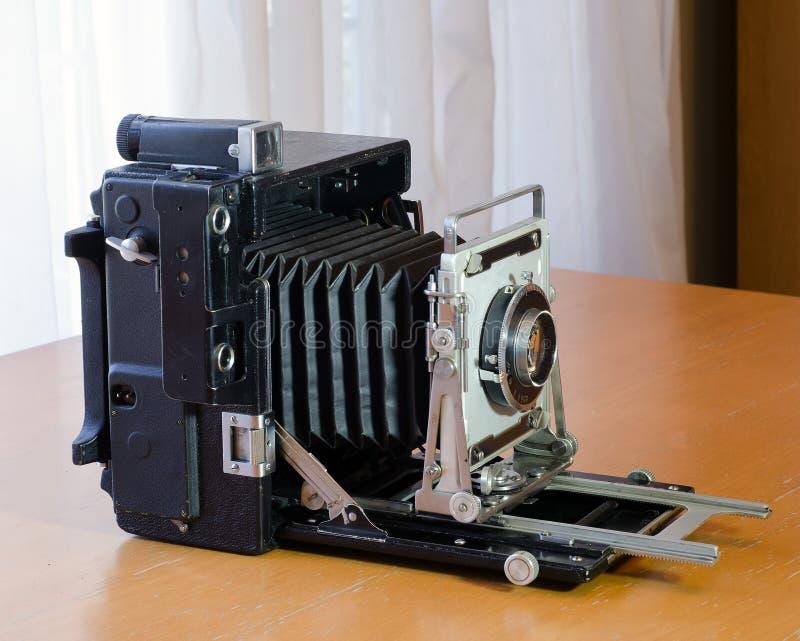 Vista lateral de la cámara de la prensa del vintage imagen de archivo libre de regalías