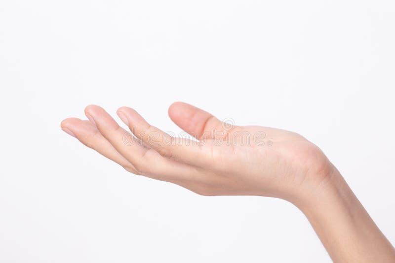 Vista lateral de la mano de la mujer sobre fondo blanco imágenes de archivo libres de regalías