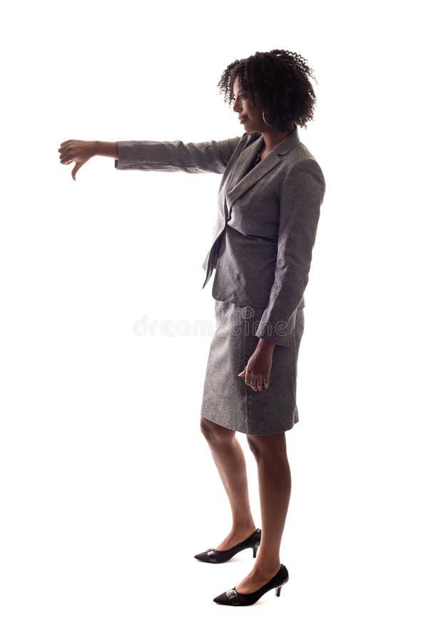 Vista lateral de la mujer de negocios con los pulgares abajo del gesto foto de archivo libre de regalías