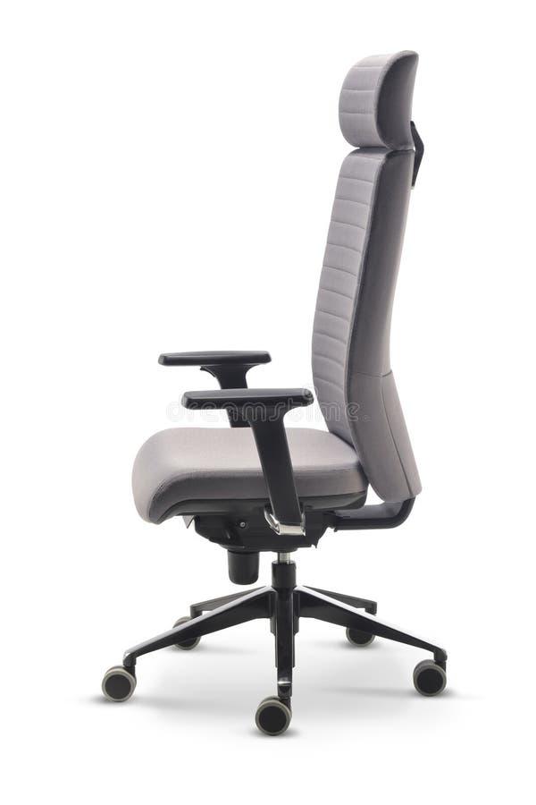 Vista lateral de la tela gris de la silla de la oficina ejecutiva foto de archivo