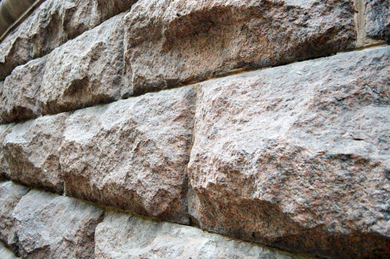 Vista lateral de los ladrillos de piedra grises grandes fotografía de archivo libre de regalías