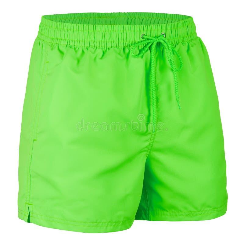 Vista lateral de los pantalones cortos de neón de los hombres verdes para nadar fotografía de archivo