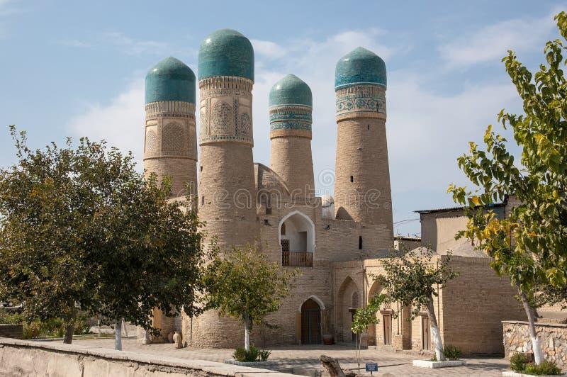 Vista lateral del menor de Chor - una mezquita histórica en Bukhara fotografía de archivo