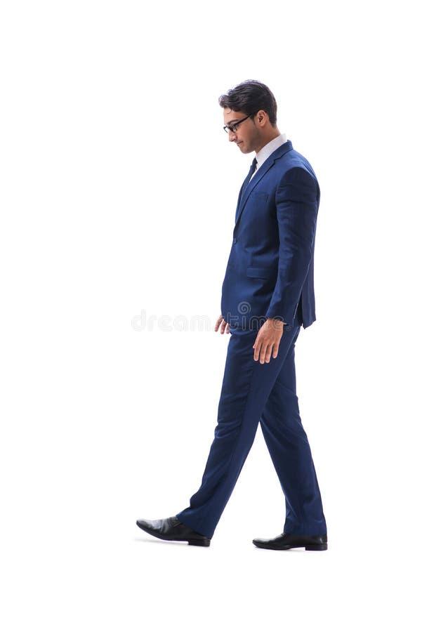 Vista lateral derecha que camina del hombre de negocios aislada en el backgro blanco imagenes de archivo