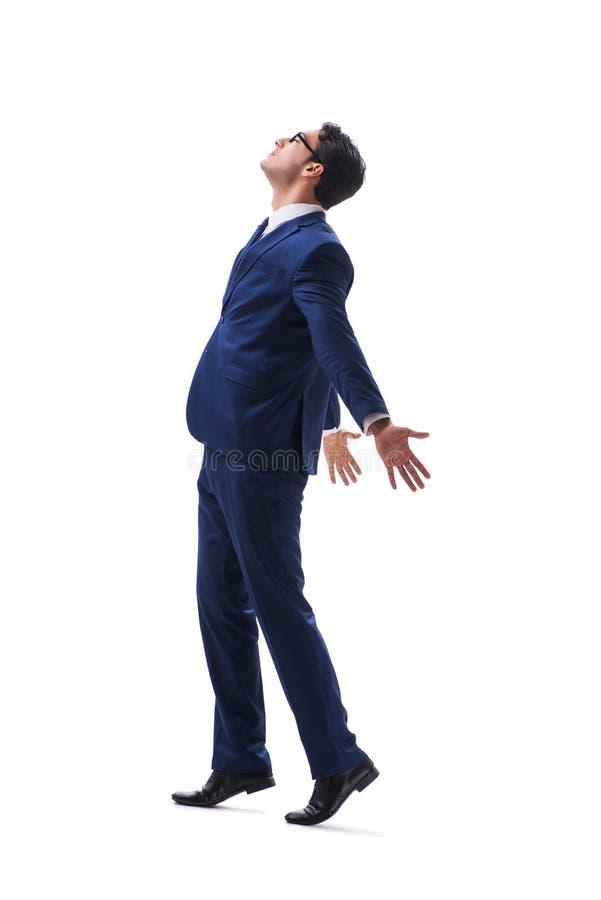 Vista lateral derecha que camina del hombre de negocios aislada en el backgro blanco foto de archivo