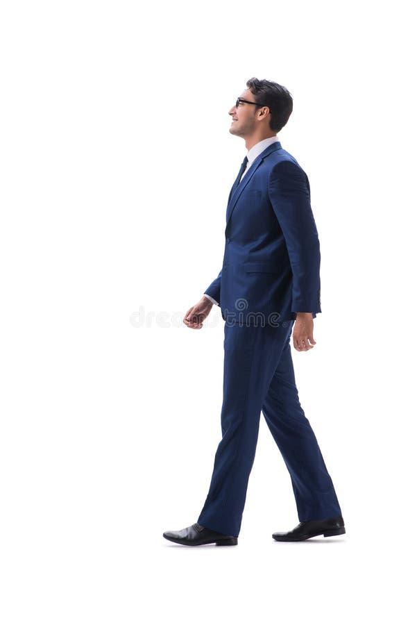 Vista lateral derecha que camina del hombre de negocios aislada en el backgro blanco fotografía de archivo libre de regalías