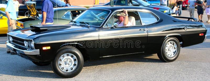 Vista lateral do carro modelo de Dodge Demon Antique dos anos 70 pretos imagens de stock royalty free