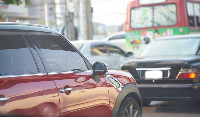 Vista lateral do mini carro na estrada fotografia de stock royalty free