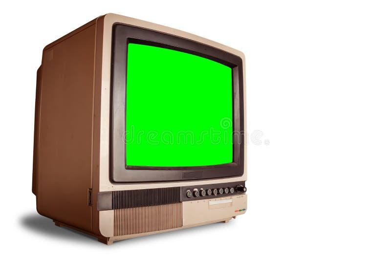 Vista lateral do receptor retro velho da tevê da casa com a tela verde vazia isolada no fundo branco com trajeto de grampeamento imagem de stock royalty free