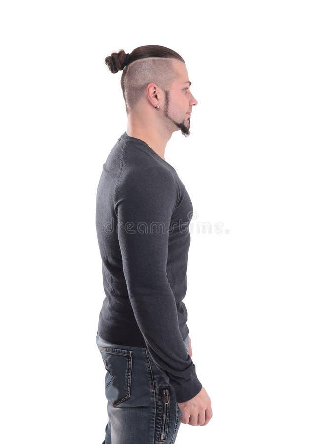 Vista lateral retrato de un hombre deportivo moderno con un peinado elegante Aislado en blanco fotos de archivo libres de regalías