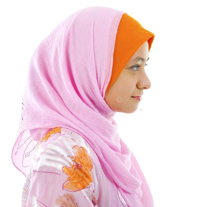Vista laterale della donna musulmana immagine stock