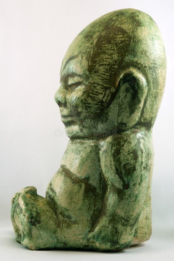 Vista laterale di Buddha miniatura immagine stock libera da diritti