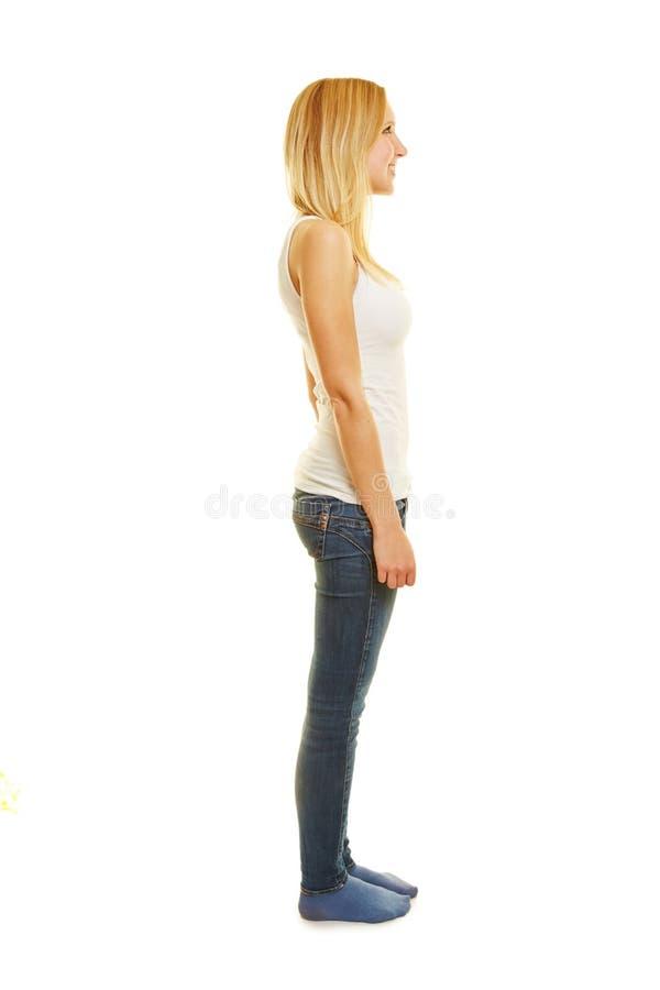 Vista laterale di giovane donna esile fotografie stock libere da diritti