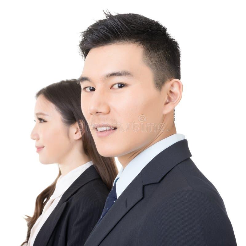 Vista laterale di giovani uomo e donna di affari fotografie stock libere da diritti