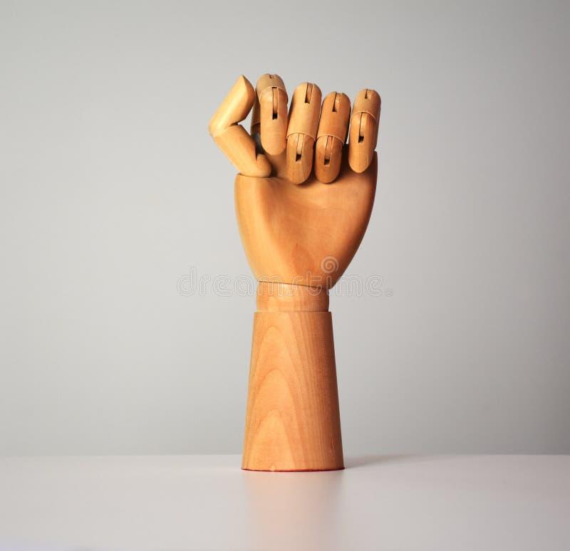 Vista mão de madeira do punho dado forma fotografia de stock