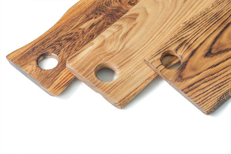 Vista molto ravvicinata di tre pannelli di legno di quercia isolati su bianco immagini stock libere da diritti