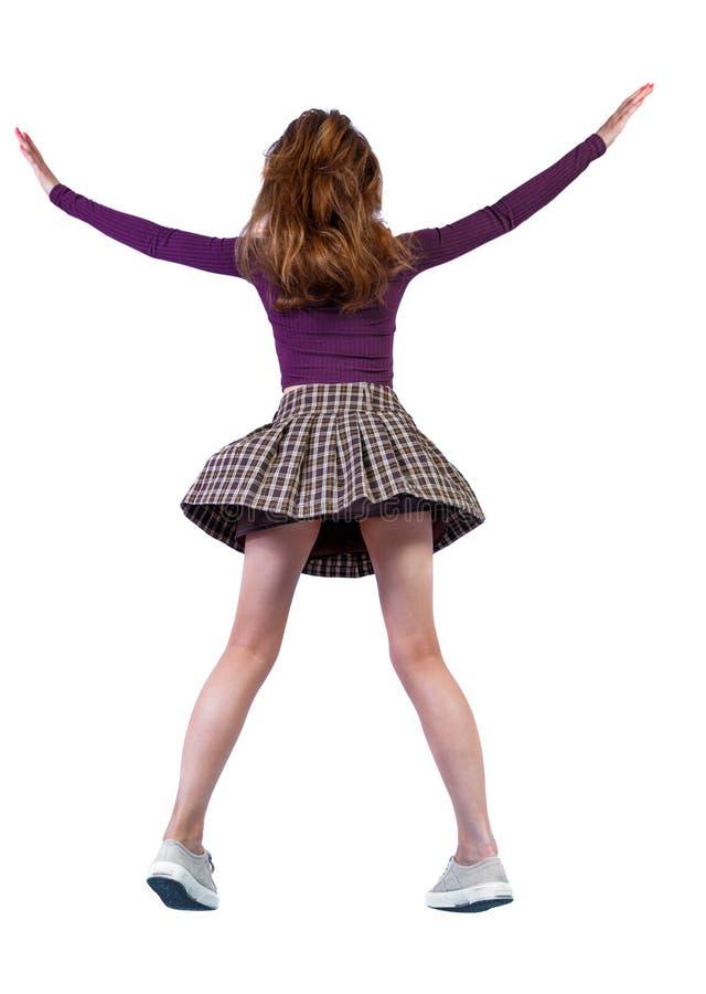 Vista posterior de la chica en un salto imagen de archivo libre de regalías