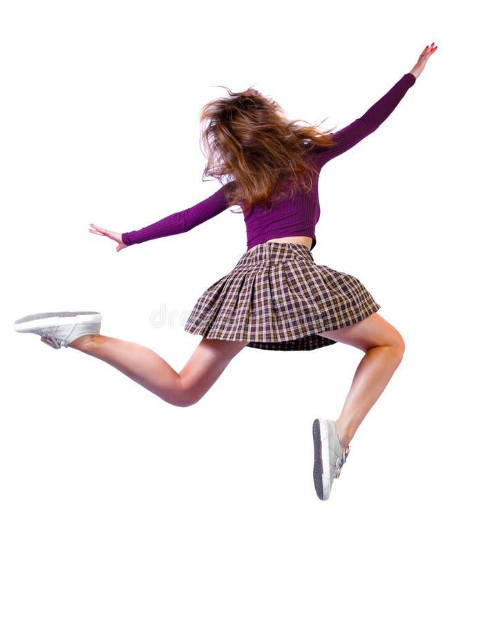 Vista posterior de la chica en un salto fotos de archivo libres de regalías
