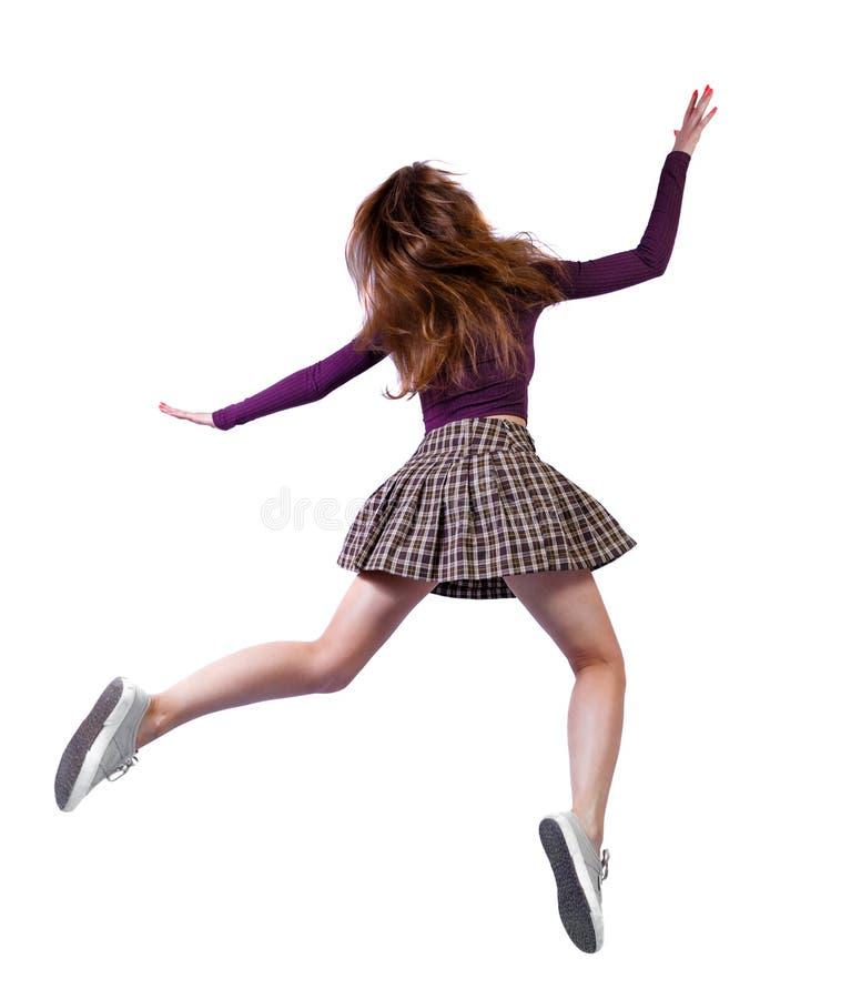 Vista posterior de la chica en un salto fotografía de archivo libre de regalías