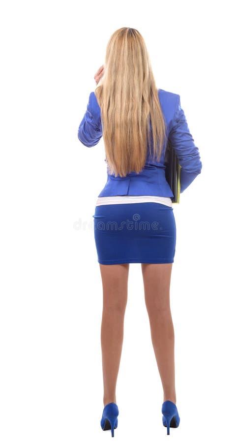 Vista posterior de la empresaria hermosa joven, aislada en blanco fotos de archivo