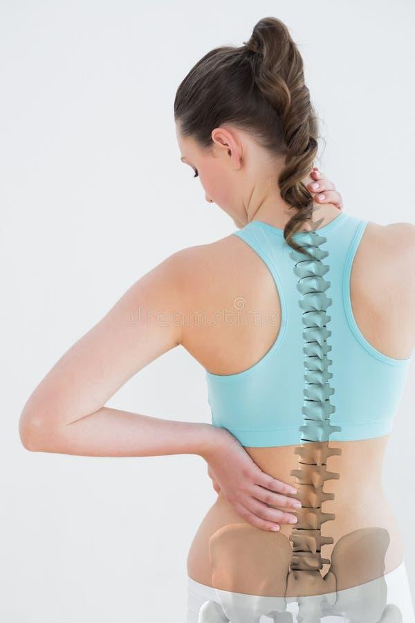 Vista posterior de la mujer que sufre de dolor de cuello fotografía de archivo libre de regalías